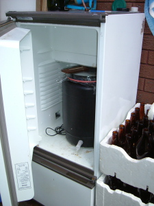 An old upside down fridge  used to regulate the temperature while the wort is fermenting