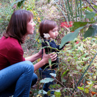 Jen Mendez with her daughter exploring the environment