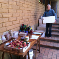 Su Dennett prepares boxed veggies for pick-up along with a range of regionally sourced bulk foods