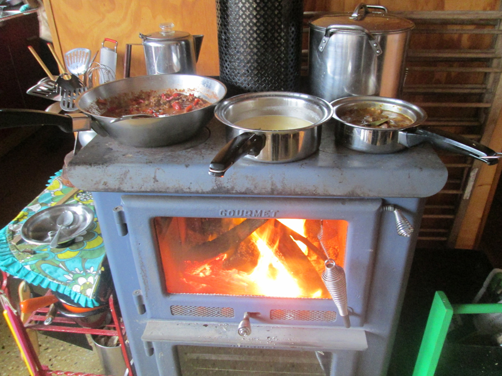 Wood stove performing multiple tasks - Cooking And Heating Cleanly With Wood